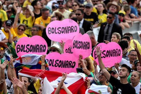 Supporters of Brazilian President-elect Jair Bolsonaro wait in front of the Planalto Palace, where he will take office, in Brasilia, Brazil, 01 January 2019. A far-right president leads the biggest Latin America democracy for first time since the end of military rule (1964-1985). Bolsonaro defeated candidate Fernando Haddad in the runoff, held last October, receiving 55 percent of the vote.
