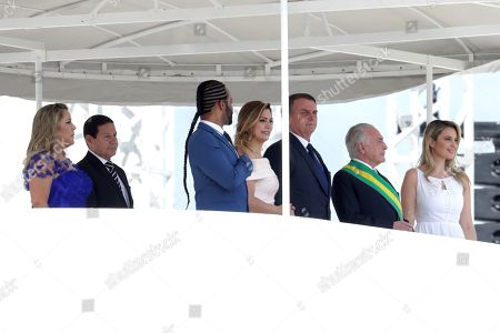 Brazilian President-elect Jair Bolsonaro (3-R), attends his inauguration ceremony next to his wife Michele (4-L), Brazilian Vice President, general at the reserve of the Army Hamilton Mourao (2-L) and his wife Paula (L) and former Brazilian President Michel Temer (2-R) and wife Marcela (R) at the Planalto Palace in Brasilia, Brazil, 01 January 2019. A far-right president leads the biggest Latin America democracy for first time since the end of military rule (1964-1985). Bolsonaro defeated candidate Fernando Haddad in the runoff, held last October, receiving 55 percent of the vote.