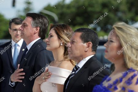 Brazilian President-elect Jair Bolsonaro (2-L) listens to the national anthem next to his wife Michele (2-L), Brazilian Vice President, general at the reserve of the Army Hamilton Mourao (2-R) and his wife Paula (R), during his inauguration ceremony at the Planalto Palace in Brasilia, Brazil, 01 January 2019. A far-right president leads the biggest Latin America democracy for first time since the end of military rule (1964-1985). Bolsonaro defeated candidate Fernando Haddad in the runoff, held last October, receiving 55 percent of the vote.