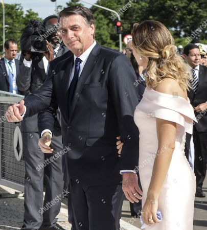 Brazilian President-elect Jair Bolsonaro (L) and wife Michele (R) head to a Rolls Royce that will take them to the Planalto Palace, where Bolsonaro will receive the presidential band from his predecessor, Michel Temer, in Brasilia, Brazil, 01 January 2019. A far-right president leads the biggest Latin America democracy for first time since the end of military rule (1964-1985). Bolsonaro defeated candidate Fernando Haddad in the runoff, held last October, receiving 55 percent of the vote.