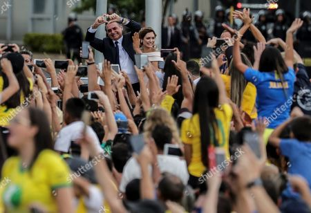 Brazilian newly inaugurated President Jair Bolsonaro (C-L) reacts next to his wife Michele (C-R) during his inauguration ceremony at the Planalto Palace in Brasilia, Brazil, 01 January 2019. A far-right president leads the biggest Latin America democracy for first time since the end of military rule (1964-1985). Bolsonaro defeated candidate Fernando Haddad in the runoff, held last October, receiving 55 percent of the vote.