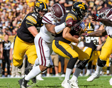 Mississippi State Bulldogs defensive tackle Jeffery Simmons (94) sacks Iowa Hawkeyes quarterback Nate Stanley (4) in the 1st half during the game between the Mississippi State Bulldogs and the Iowa Hawkeyes in the Outback Bowl at Raymond James Stadium in Tampa, Florida