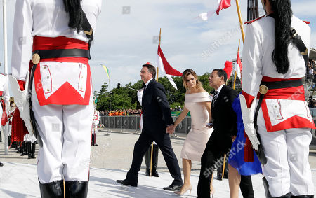 Brazil's President Jair Bolsonaro and his wife Michelle Bolsonaro, left, and Vice President Hamilton Mourao and his wife Paula Mourao, walk up the ramp to meet Brazil's outgoing President Michel Temer and his wife Marcela Temer, at the Planalto Presidential palace, in Brasilia, Brazil