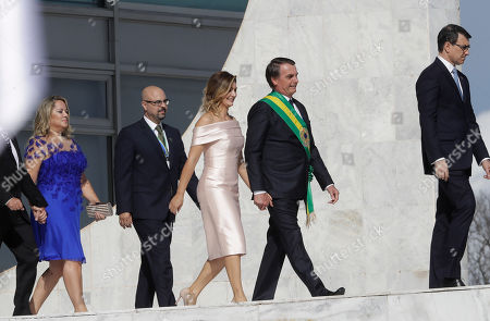 Stock Image of Brazil's new President Jair Bolsonaro and his wife Michelle Bolsonaro, and Vice President Hamilton Mourao and his wife Paula Mourao, right, walk up the ramp to meet Brazil's outgoing President Michel Temer and his wife Marcela Temer, at the Planalto Presidential palace, in Brasilia, Brazil