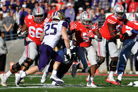 Stock Photo of Ohio State Buckeyes running back Mike Weber Jr. #5 runs for 10 yards past Washington Huskies linebacker Ben Burr-Kirven #25 in the first quarter during the 105th Rose Bowl College football game between the Ohio State Buckeyes and the Washington Huskies at the Rose Bowl in Pasadena, California