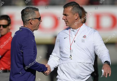 Ohio State head coach Urban Meyer, right, and Washington head coach Chris Petersen shake hands before the Rose Bowl NCAA college football game, in Pasadena, Calif