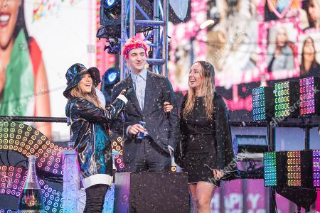 Stock Picture of Allison Hagendorf, Tyler 'Ninja' Blevins. Allison Hagendorf, left and Tyler 'Ninja' Blevins on stage at the New Year's Eve celebration in Times Square, in New York