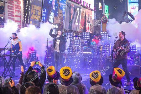 Kyle Simmons, Dan Smith, Chris Wood, Will Farquarson. Kyle Simmons, from left, Dan Smith, Chris Wood and Will Farquarson of Bastille perform at the New Year's Eve celebration in Times Square, in New York