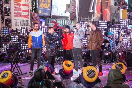 Ryan Seacrest, Kyle Simmons, Chris Wood, Dan Smith, Will Farquarson. Ryan Seacrest, second from left, appears with Kyle Simmons, Chris Wood, Dan Smith and Will Farquarson of Bastille at the New Year's Eve celebration in Times Square, in New York