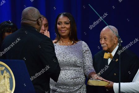 Letitia James, joined by David Dinkins, takes the oath of office as New York Attorney General at Ellis Island