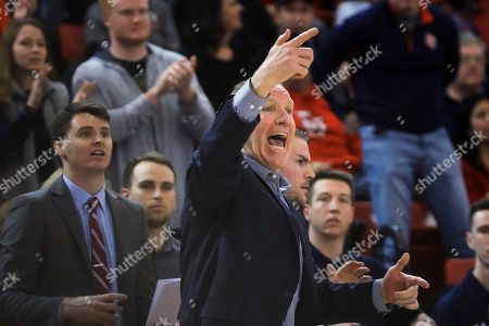St. John's coach Chris Mullin shouts to the team during the first half of an NCAA college basketball game against Marquette, in New York