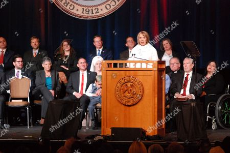 Democratic New Mexico Gov. Michelle Lujan Grisham urges greater state spending on public education during her inaugural address, in Santa Fe, N.M. The top job in New Mexico passed from one Latina governor to another Tuesday as Michelle Lujan Grisham succeeded termed-out Republican Susana Martinez