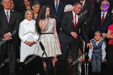 """Teenage country singer Chevel Sheperd (center, foreground) of New Mexico belts out """"God Bless America"""" at the inauguration of New Mexico Gov. Michelle Lujan Grisham (left center) and Lt. Gov. Howie Morales (right center), in Santa Fe, N.M. The top job in New Mexico passed from one Latina governor to another Tuesday as Michelle Lujan Grisham succeeded termed-out Republican Susana Martinez. Nationwide, Democrats will hold 23 governorships after inaugurations"""