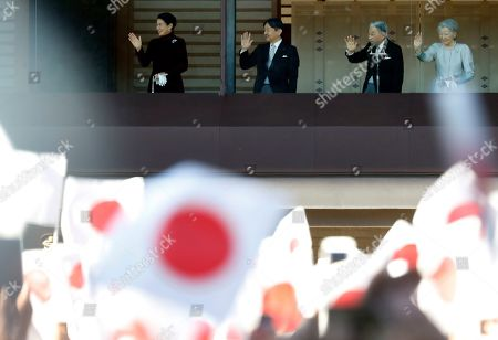 Akihito, Michiko, Naruhito, Masako. Japan's Emperor Akihito, second from right, waves with Empress Michiko, right, Crown Prince Naruhito and Crown Princess Masako to well-wishers from the balcony during his New Year's public appearance with his imperial families at Imperial Palace in Tokyo