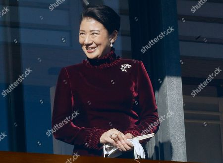 Japan's Crown Princess Masako smiles from the balcony during the New Year's public appearance to well-wishers with Japan's Emperor Akihito's family members at Imperial Palace in Tokyo . Akihito waved Wednesday to throngs of well-wishers eager to see the final New Year's appearance in his reign