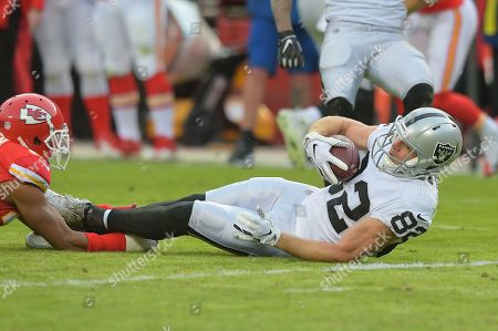 Oakland Raiders wide receiver Jordy Nelson (82) is brought down by a shoe string tackle during the NFL Football Game between the Oakland Raiders and the Kansas City Chiefs at Arrowhead Stadium in Kansas City, Missouri