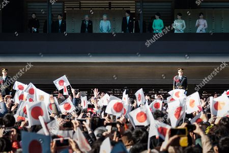 (From left to right) Crown Princess Masako, Crown Prince Naruhito, Japan's Emperor Akihito, accompanied by his wife Empress Michiko, Prince Akishino Fumihito, Princess Akishino Kiko, Princess Mako and Princess Kako wave to well-wishers on the balcony of the Imperial Palace to celebrate the new year