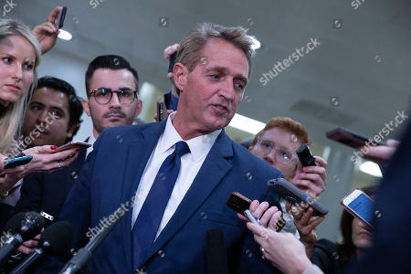 Senator Jeff Flake, Republican of Arizona, speaks with reporters in the United States Capitol Building in Washington, DC on November 28, 2018.