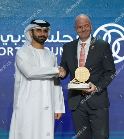 Stock Image of Gianni Infantino (R), FIFA President receives an award from HH Sheikh Mansour bin Mohammed bin Rashid Al Maktoum (L), President of the Dubai International Marine Club, during the first day of the 13th edition of Dubai International Sports Conference in the Gulf emirate of Dubai, United Arab Emirates, 02 January 2019.