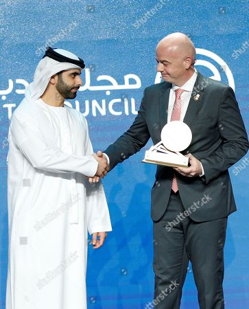 Gianni Infantino (R), FIFA President receives an award from HH Sheikh Mansour bin Mohammed bin Rashid Al Maktoum (L), President of the Dubai International Marine Club, during the first day of the 13th edition of Dubai International Sports Conference in the Gulf emirate of Dubai, United Arab Emirates, 02 January 2019.
