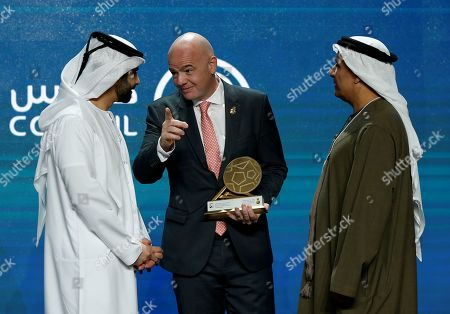 Gianni Infantino (C), FIFA President receives an award from HH Sheikh Mansour bin Mohammed bin Rashid Al Maktoum (L), President of the Dubai International Marine Club, during the first day of the 13th edition of Dubai International Sports Conference in the Gulf emirate of Dubai, United Arab Emirates, 02 January 2019.