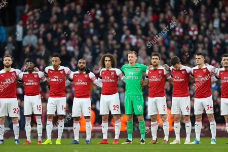 Stock Picture of The team stands for a minute's silence in remembrance of former Arsenal chairman Peter Hill-Wood