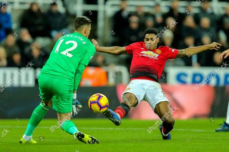 Marcus Rashford (#10) of Manchester United stretches to reach a through pass but is beaten to the ball by Martin Dubravka (#12) of Newcastle United during the Premier League match between Newcastle United and Manchester United at St. James's Park, Newcastle