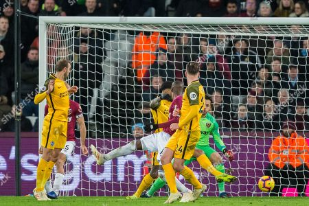 Glenn Murphy (Brighton) looks on as a goal is scored by Dale Stephens (Brighton) during the Premier League match between West Ham United and Brighton and Hove Albion at the London Stadium, London