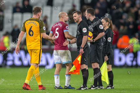 Dale Stephens (Brighton) & Pablo Zabaleta (Capt) (West Ham) shaking hands with Dan Cook (Assistant Referee), Christopher Kavanagh (Referee) and Sian Massey-Ellis (Assistant Referee) following the Premier League match between West Ham United and Brighton and Hove Albion at the London Stadium, London