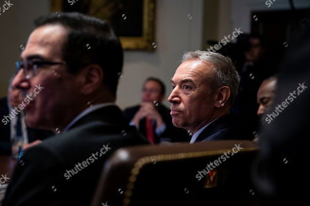 Stock Picture of Stephen Censky, U.S. deputy secretary of Agriculture, listens beside Steven Mnuchin, U.S. Treasury secretary, as President Trump speaks during a cabinet meeting in the Cabinet Room of the White House, in Washington, D.C.