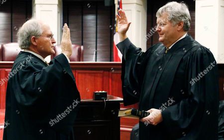 T. Kenneth Griffis, William Waller Jr. State Supreme Court Chief Justice William Waller, Jr., left, leads Presiding Appeals Judge T. Kenneth Griffis, through his oath of office as the new Appeals Chief Judge, during a brief ceremony, in Jackson, Miss. Griffis, of Ridgeland, will serve as administrative head of the Court of Appeals Jan. 2 through Jan. 31. Gov. Phil Bryant has appointed him to a vacancy on the Supreme Court, the state's highest court, effective Feb. 1
