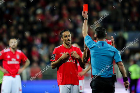 Referee Manuel Mota (R) shows the red card to Jonas of Benfica during their Portuguese First League soccer match held at Portimonense Stadium, Portimao, Portugal, 2nd January 2019.