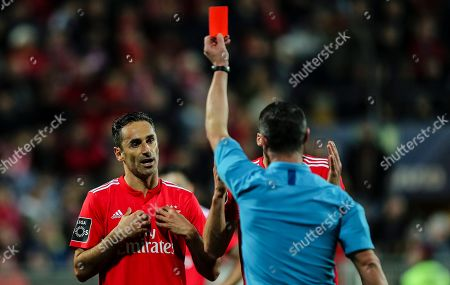 Stock Image of Referee Manuel Mota (R) shows the red card to Jonas of Benfica during their Portuguese First League soccer match held at Portimonense Stadium, Portimao, Portugal, 2nd January 2019.