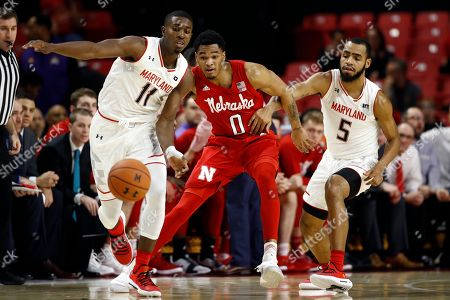 Darryl Morsell, James Palmer, Eric Ayala. Maryland guard Darryl Morsell, from left, Nebraska guard James Palmer and Maryland guard Eric Ayala chase after a loose ball in the first half of an NCAA college basketball game, in College Park, Md