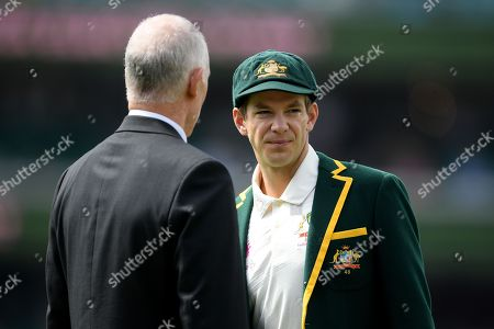 Australian captain Tim Paine (R) leaves the field with national selector Greg Chappell (L) after the toss during day one of the fourth Test match between Australia and India at the Sydney Cricket Ground (SCG) in Sydney, Australia, 03 January 2019.