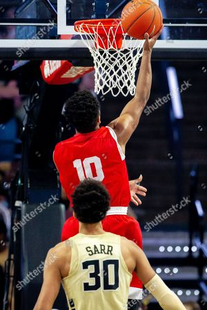 Cornell Big Red guard Matt Morgan (10) puts up the layup as Wake Forest Demon Deacons center Olivier Sarr (30) watches in the NCAA Basketball matchup at LJVM Coliseum in Winston-Salem, NC