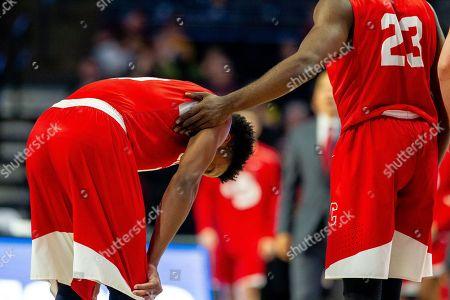 Cornell Big Red guard Matt Morgan (10) gets support from guard Joel Davis (23) after a tiring series in the NCAA Basketball matchup at LJVM Coliseum in Winston-Salem, NC