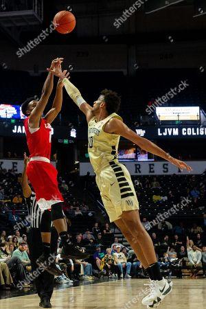 Cornell Big Red guard Matt Morgan (10) shoots over Wake Forest Demon Deacons center Olivier Sarr (30) in the NCAA Basketball matchup at LJVM Coliseum in Winston-Salem, NC