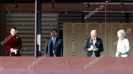 Japanese Emperor Akihito (2nd R), accompanied by Empress Michiko (R), Crown Prince Naruhito (2nd L) and Crown Princess Masako (L) delivers a speech to wellwishers gathered for New Year's greetings at the Imperial Palace in Tokyo on Wednesday, January 2, 2019. Some 154,000 people visited the Imperial Palace on the day to congratulate the Imperial family for the New Year.
