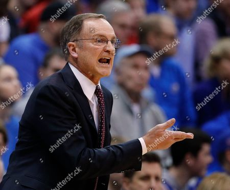 Oklahoma coach Lon Kruger questions a call during the first half of the team's NCAA college basketball game against Kansas, in Lawrence, Kan