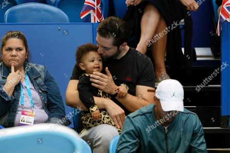 Serena Williams husband Alexis Ohanian holds their daughter Olympia during her match against Britain's Katie Boulter of the Hopman Cup in Perth, Australia