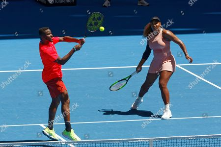 Serena Williams, Frances Tiafoe. Serena Williams of the United States watches as her compatriot partner Frances Tiafoe plays a shot during their mixed doubles match against Britain's Katie Boulter and Cameron Norrie at the Hopman Cup in Perth, Australia