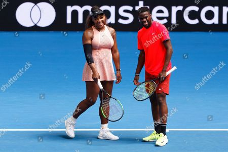 Serena Williams, Frances Tiafoe. Serena Williams of the United States, left, and her compatriot partner Frances Tiafoe smile during their mixed doubles match against Britain's Katie Boulter and Cameron Norrie at the Hopman Cup in Perth, Australia