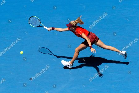 Katie Boulter of Britain stretches to reach the ball during her match against Serena Williams of the United States at the Hopman Cup in Perth, Australia