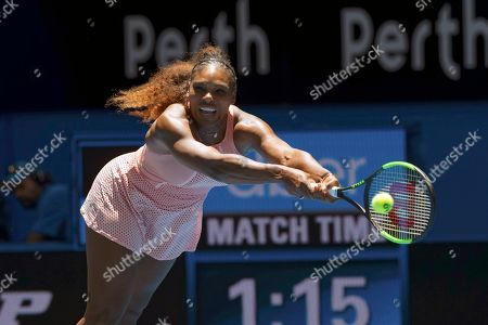 Serena Williams of the United States returns the ball during her match against Britain's Katie Boulter of the Hopman Cup in Perth, Australia