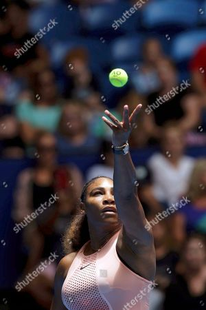 Serena Williams of the United States serves during her match against Britain's Katie Boulter of the Hopman Cup in Perth, Australia