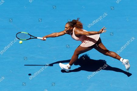 Serena Williams of the United States stretches during her match against Britain's Katie Boulter of the Hopman Cup in Perth, Australia