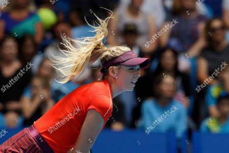 Hair of Britain's Katie Boulter flies as she plays a shot during her match against Serena Williams of the United States at the Hopman Cup in Perth, Australia