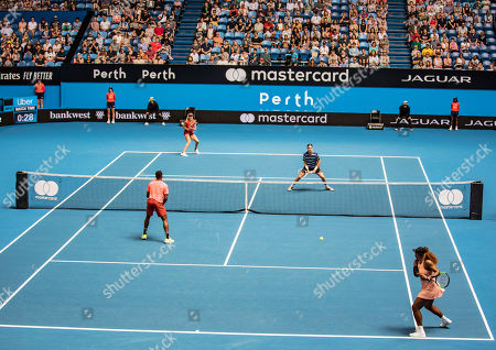 Frances Tiafoe with Serena Williams of the USA against Katie Boulter with Cameron Norrie of Britain during the mixed doubles match between Britain and the USA on day 6 of the Hopman Cup tennis tournament at RAC Arena in Perth, Australia, 03 January 2019.