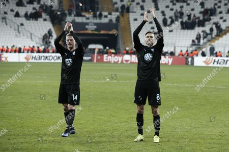 Anders Christiansen and Arnor Ingvi Traustason of Malmo celebrate with their supporters their qualification to the round of 32 at the end of the Europa League Group I Besiktas JK against Malmo FF